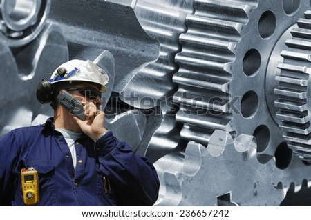 engineer, worker with large cogwheels machinery - stock photo