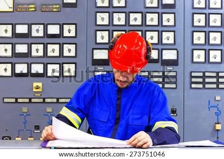 Engineer working in the industrial interior - stock photo