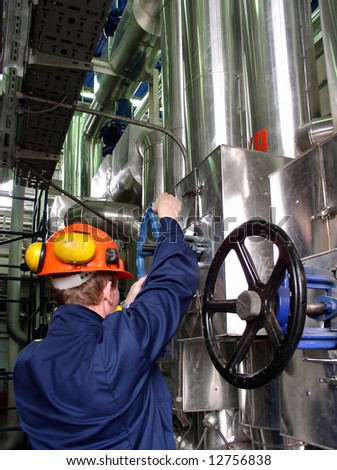 Engineer working in the plant - stock photo