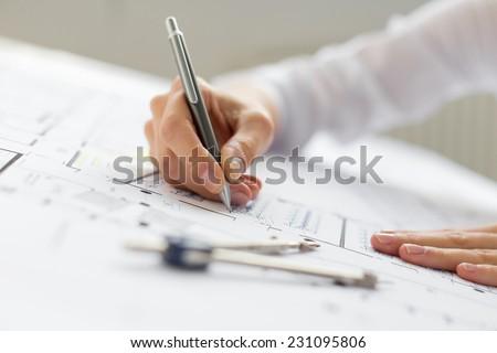 Engineer working on blueprint - stock photo