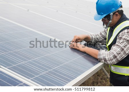 engineer working on  maintenance equipment at industry solar power: working on Wrench tightening solar mounting structure of solar panel