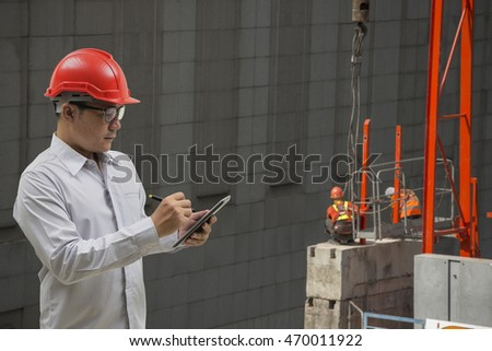 engineer working on table site. on blurred construction site backgrounds
