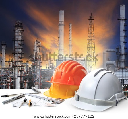 engineer working table in oil refinery plant heavy petrochemical industry estate use for energy,power,fuel ,gas and fossil petroleum topic - stock photo