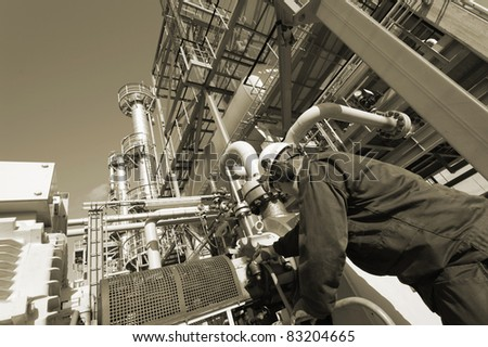 engineer working with pipeline machinery, brown toning concept - stock photo