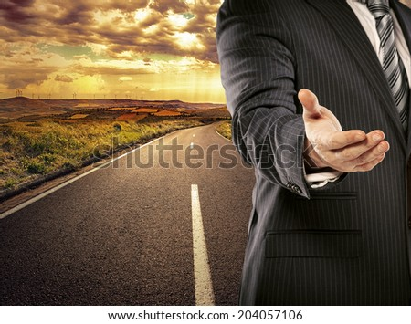 Engineering agreement, solution and partnership. Business man on straight asphalt road greeting new construction partner.   - stock photo