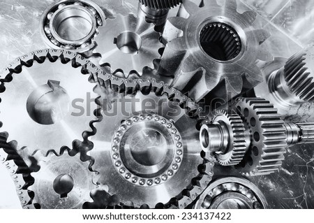 engineering, cogwheels, gears and chains, titanium and steel - stock photo