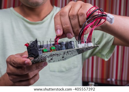Engineering Connecting Wires To A Motherboard - stock photo