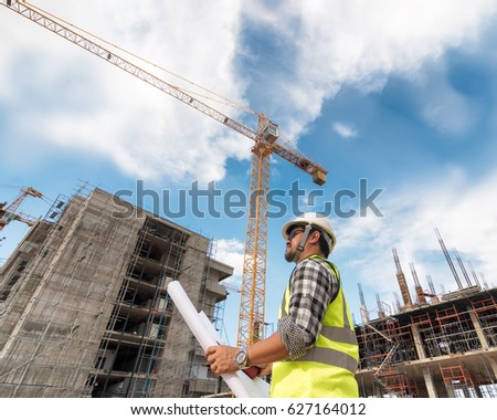 Engineering consulting people on construction site stock photo engineering consulting people on construction site holding blueprint in his hand building inspector construction malvernweather Gallery