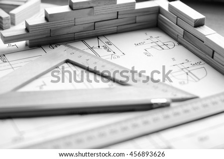 Engineering drawing equipment, paper, ruler and pencil - stock photo