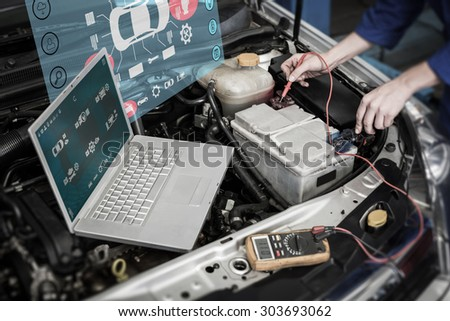 Engineering interface against mechanic using diagnostic tool on engine - stock photo