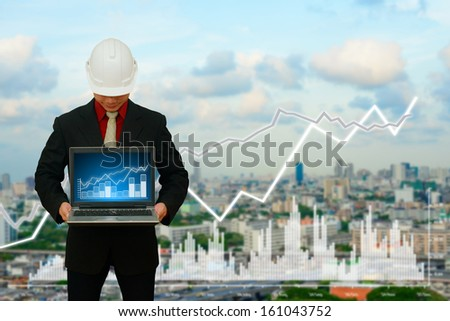 Engineering looking the data from laptop - stock photo