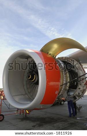 engineering maintenance of large jet engine turbine stock photo