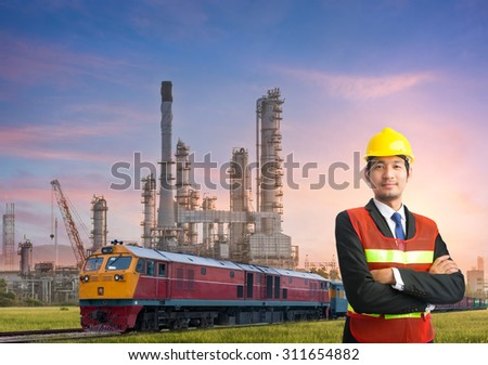 engineering man and safety helmet, shirts standing arms crossed against oil refinery plant in petrochemical industr
