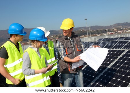 Engineering professional with group of students in training - stock photo
