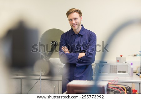 Engineering student smiling at camera at the university - stock photo