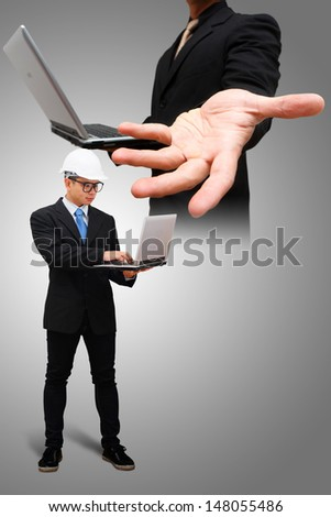Engineering working with laptop - stock photo
