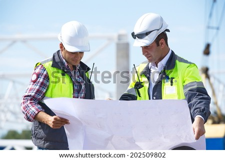 Engineers At Construction Site - stock photo