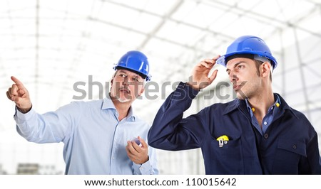 Engineers at work in a construction site - stock photo