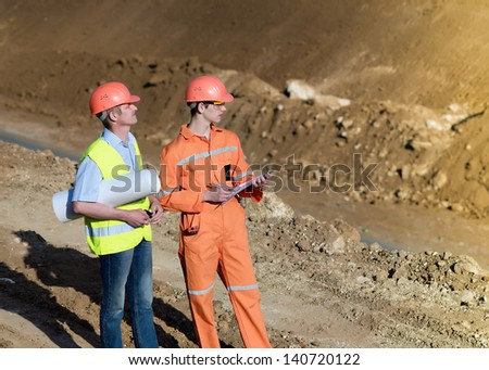 Engineers construction firm. Construction of a new road. Workers repairing the road