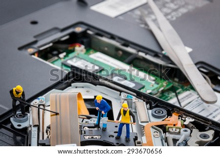 Engineers Fixing Computer Circuit Board, miniature people - stock photo