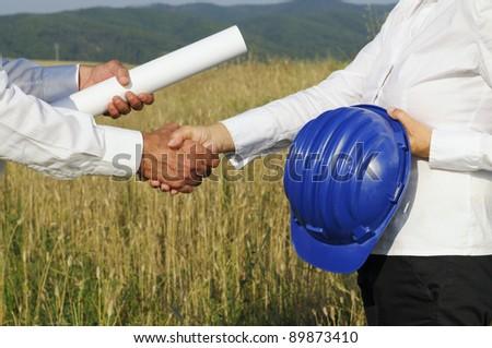 Engineers handshaking - stock photo