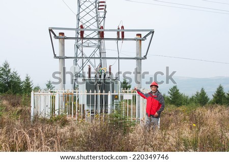 Engineers in the wind power field of grassland - stock photo