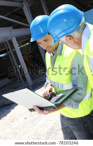 Engineers meeting on building site - stock photo