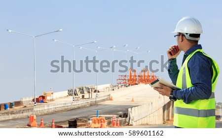 Engineers on construction sites, road and bridge.