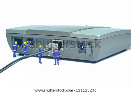 Engineers repairing LAN internet connection on a router - stock photo