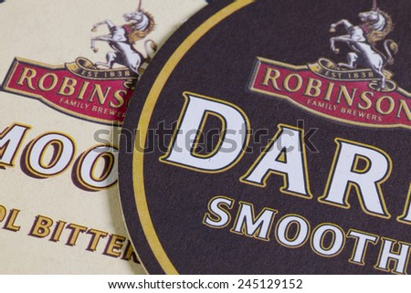 ENGLAND,LONDON - November 11, 2014: Beermats from Robinsons beer.Robinsons is a family-run,regional brewery founded in 1859 by Frederic Robinson at the Unicorn Inn,Stockport, England.
