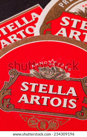 ENGLAND,LONDON - November 11, 2014:Beermats from Stella Artois.It has been brewed in Leuven, Belgium, since 1926.Stella Artois is one of the prominent brands of Anheuser-Busch InBev - stock photo