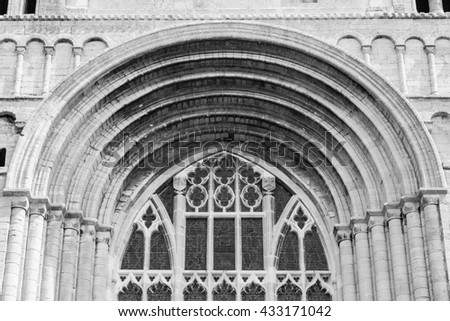 England, Tewkesbury - 29 May 2016: Tewkesbury Abbey, Parish Church of St Mary the Virgin Facade Norman Arch A black and white photography