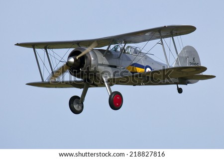England UK circa 2014 An unnamed pilot flies the Gloster Gladiator BiPlane at a vintage air pageant