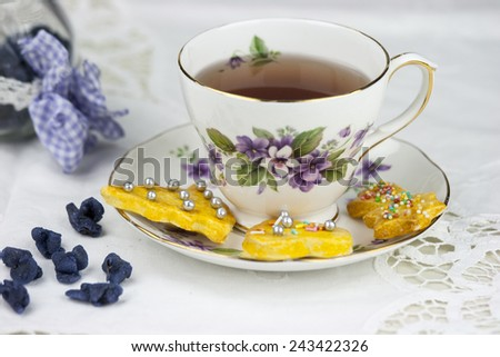 English afternoon tea with cookies and candied violets - stock photo