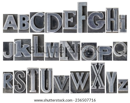 English alphabet - a collage of 26 isolated letters in letterpress metal type printing blocks, a variety of mixed fonts - stock photo