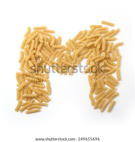 English Alphabet spelled by Pasta Macaroni. Capital letter M - stock photo