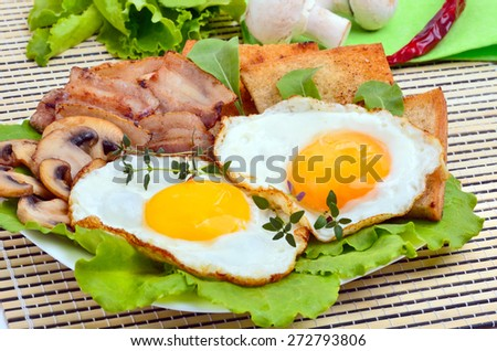 English breakfast -  egg, toast, bacon and vegetables on a white plate - stock photo