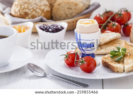 English breakfast on white wooden table. Studio shot - stock photo