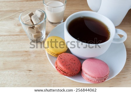 English breakfast tea and macarons on wood  deck for background - stock photo