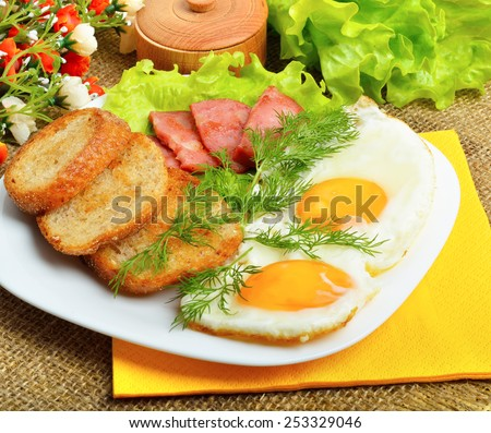 English breakfast - toast, egg, bacon and vegetables, sacking background. - stock photo
