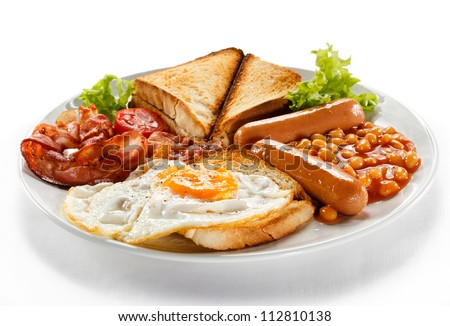 English breakfast - toast, egg, bacon, sausages, beans and vegetables on white background