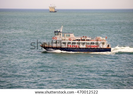 ENGLISH CHANNEL- JULY 25, 2016: Passenger boat floating by English Channel near St. Peter Port, Guensey. The Herm Trident Ferry sails daily from the St Peter Port Harbour.