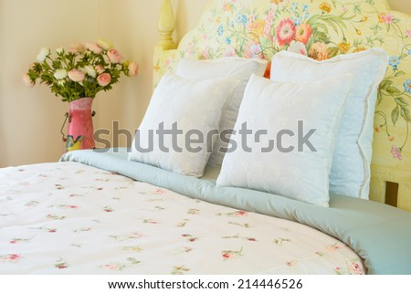 English country style bed with white pillows - stock photo