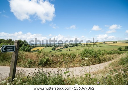 English countryside, with public footpath sign, wide angle image. - stock photo
