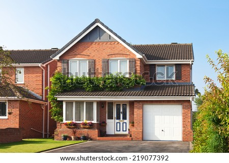 English detached house covered green - stock photo