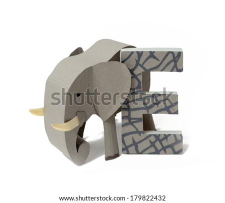 English E letter and object cut from paper