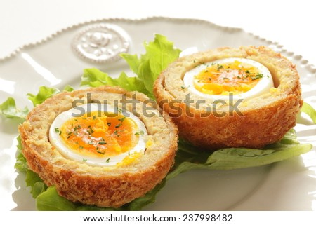 English food, Scotch egg served on lettuce - stock photo