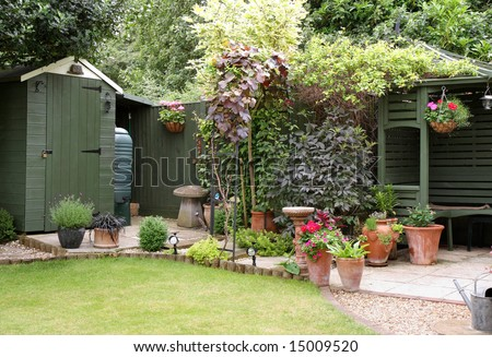 English Garden Patio Area with planters, flowerpots flowers and plants - stock photo