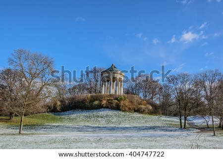 English Garden Rotunda in Munich (German). Famous white gazebo in the biggest park in Munich. Winter season. - stock photo