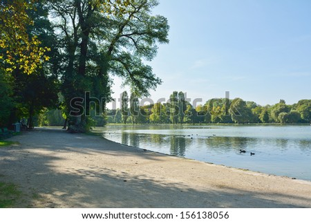 English Garden with the Kleinhesseloher Lake in Munich Germany  - stock photo